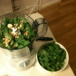 Basil, olive oil, garlic and pine nuts to mixer