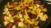 3. Put the fried vegetable to frying pan with sausage & potato and add pepper and oregano.