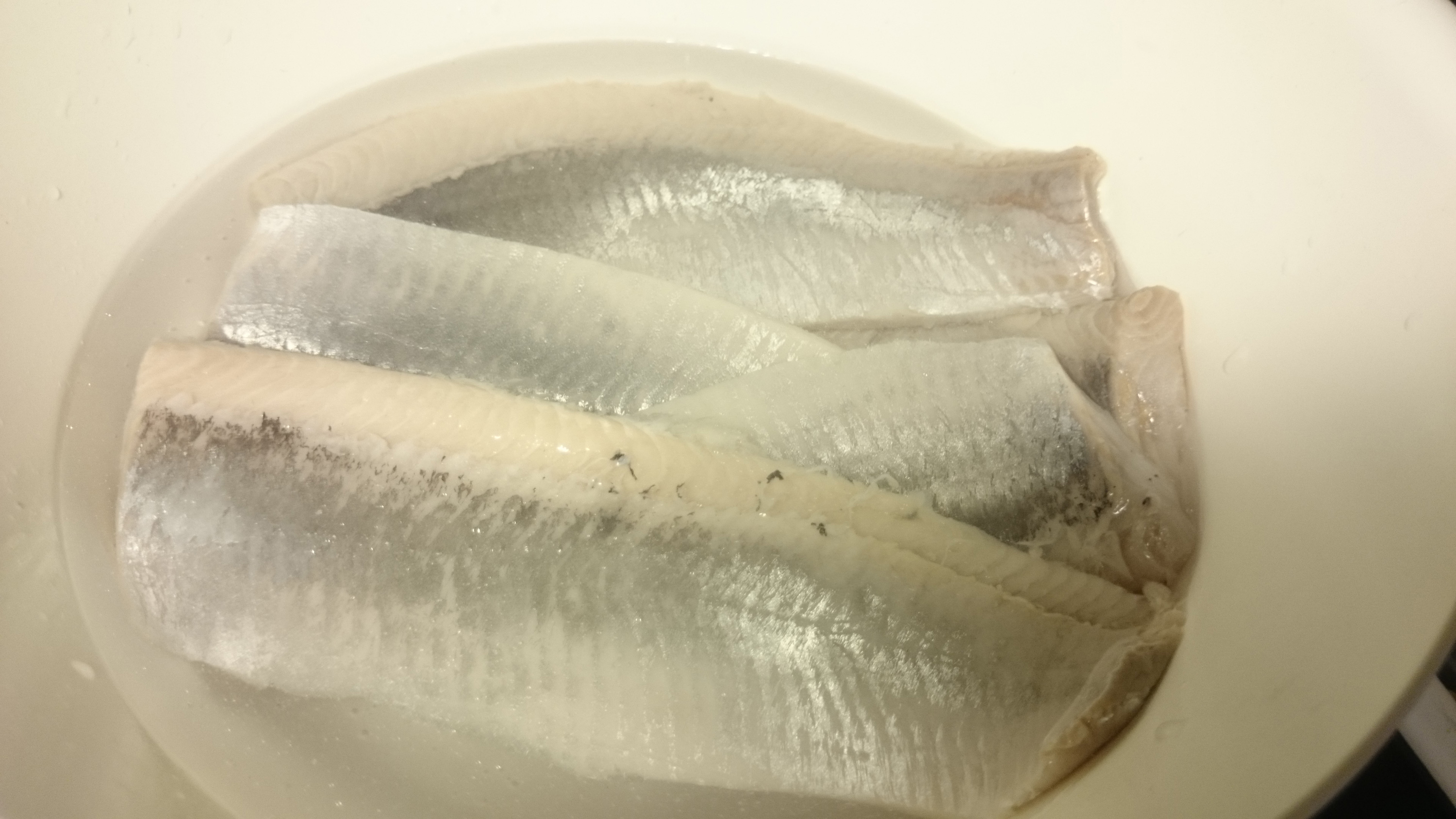 1. Put the herrings in water and leave in refrigerator for one night.